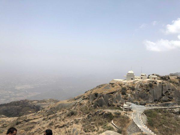 <span>At the top of the Aravalli Range</span><i>→</i>